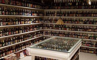 Thousands of beer bottles lined up on basement shelves