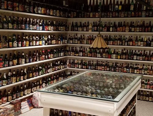 Thousands of beer bottles lined up on basement shelves
