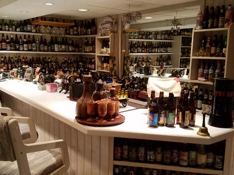 Overview of Basement lined with shelves of beer bottles